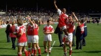 Ian Wright and Andy Linighan of Arsenal